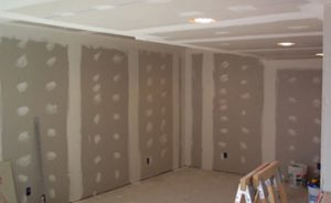 Drywall/Gypsum installed with drywall compound applied to seams and screws