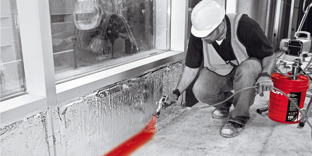 Firestop (by Hilti) being sprayed on where the wall and floor meet